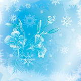 Three icy lily with buds on a blue background with snowflakes and frosty pattern. Royalty Free Stock Photography