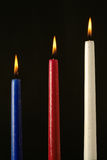 Three ignited wax candles. Over black background Royalty Free Stock Photo