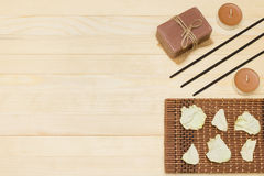 Three incense sticks and candle with soap Stock Photo