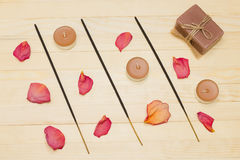Three incense sticks and candle with soap Royalty Free Stock Photography