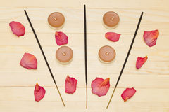 Three incense sticks and candle Royalty Free Stock Photos