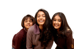 Three indian friends. Happy smiling indian sisters indoor Royalty Free Stock Photography
