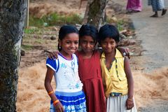 Three Indian girls on the street in fishing village Stock Images