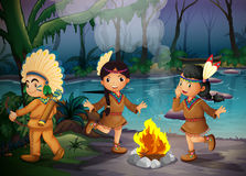 Three Indian kids inside the forest Stock Image
