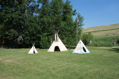 Three indian teepees on a lawn in idaho. Stock Images