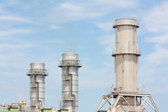 Three industrial chimneys Royalty Free Stock Photos