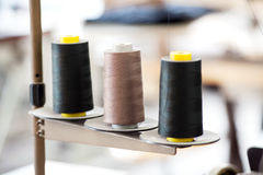 Three Industrial Spools of Thread Stock Images