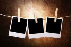 Three Instant Photos on a grunge background Royalty Free Stock Images