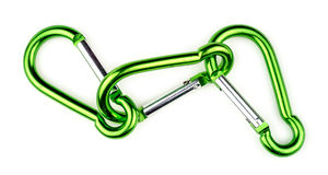 Three interlocked green carabiner clasps for mountain climbing Royalty Free Stock Photography