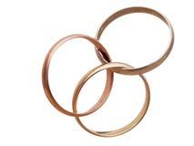 Three interlocking wedding rings. Modern marriage? Bigamy? Stock Images