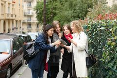 International students learning English and walking outside in. Three international students learning English and passing in  . Concept of language courses and Stock Photo