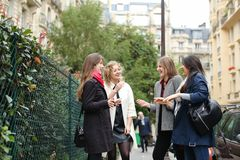 International students learning English and walking outside in. Three international students learning English and passing in  . Concept of language courses and Royalty Free Stock Image