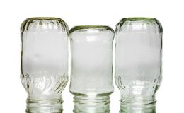 Three inverted jars on white. Background royalty free stock image