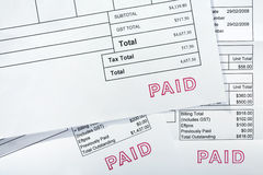 Three Invoices All With Paid Stamp Stock Photos