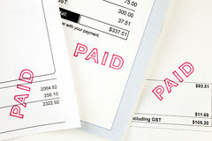 Three Invoices with Paid Stamp. Three invoices, all have been stamped paid Royalty Free Stock Photo