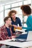Three involved students sharing ideas and opinions about differe. Nt topics and new information learned during courses at the university Royalty Free Stock Images