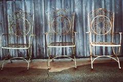 Three iron chairs stock photo