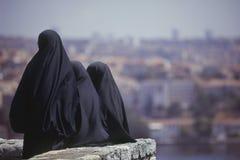 Islamic women wearing burqua, Istanbul. Three Islamic women dressed in black turning their back. Istanbul, Turkey stock photos