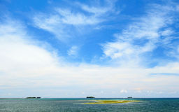 Three islands. On the horizon in the Pacific Ocean. View from the island of Siargao in the Philippines Royalty Free Stock Photo