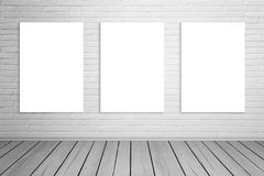 Three isolated art canvas on brick wall for mockup Royalty Free Stock Image