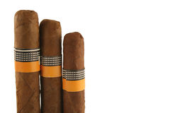 Three isolated cigars on white Stock Images