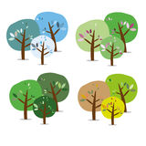 Three isolated colorful seasonal trees Stock Photography