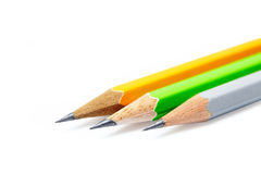 Three isolated colour pencils Royalty Free Stock Photos