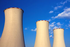 Three isolated cooling towers. Of nuclear power station Royalty Free Stock Images
