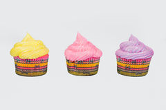Three isolated cupcakes in a row Royalty Free Stock Photography