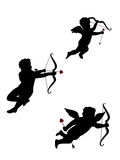 Three isolated Cupids. Three isolated flying Cupids silhouette royalty free illustration