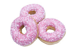 Three isolated doughnuts Stock Images