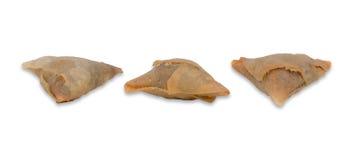 Three isolated freshly baked samosas Stock Photo
