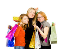 Three isolated girls out for shopping. Isolated on white background Stock Photos