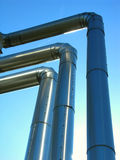 Three isolated pipelines on blue sky. Three isolated pipelines from steel on blue sky Royalty Free Stock Images