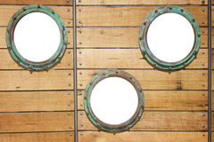 Three isolated portholes Royalty Free Stock Photos