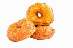 Three isolated round doughnuts Stock Photos