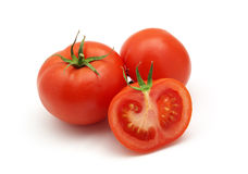 Three isolated tomatoes Royalty Free Stock Photos