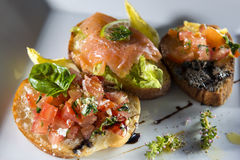 Three italian bruschetta Royalty Free Stock Photography