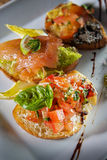 Three italian bruschetta Stock Photography