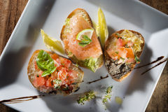 Three italian bruschetta Stock Images
