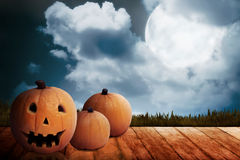 Three Jack O'Lantern on the wooden floor Royalty Free Stock Photo