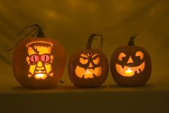 Three jack-o-Lanterns. A trio of three carved pumpkins Stock Photography