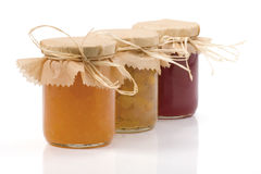 Three Jam jar isolated. On a white background. Apples, cabbage-cardamom jam jar, Orange jam and Currant jam jar. With clipping path. Shallow DOF. Focused on the stock image