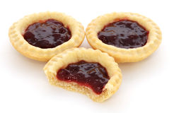 Three jam tarts, one with a bite taken Royalty Free Stock Photography