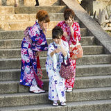 Three Japanese girls on traditional clothes making a picture Royalty Free Stock Photography
