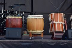 Three Japanese Taiko Nagado and Okedo drums standing in a row on stage royalty free stock photography