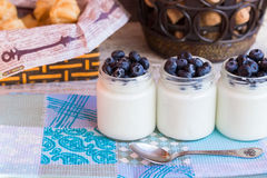 Three jar homemade yogurt with berries. Homemade yogurt with blueberries in a glass jar Stock Photos