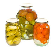 Three Jar With Cucumbers And Tomatoes Royalty Free Stock Images