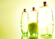 Three Jars. Three glass jars isolated with yellow/green tint. Middle jar contains uncooked rice. Cork tops. High key against tinted background. Space for copy stock photos