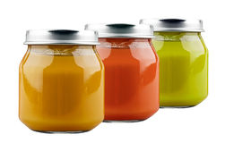 Three jars of baby food. On white background royalty free stock image